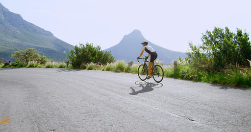 Senior cyclist cycling on a road 4k Live Action