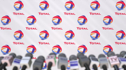 News conference of TOTAL, press wall with logo as a background and mics Footage