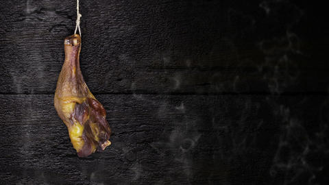 Chicken Meat Hanging On The Rope Against Rustic Wooden Background GIF