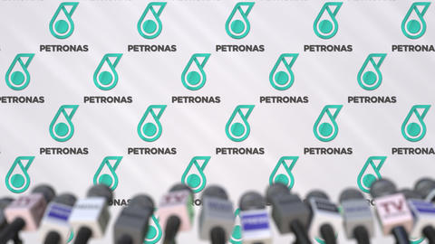 Media event of PETRONAS, press wall with logo and microphones, editorial Footage