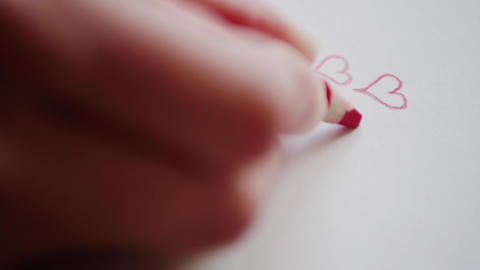 Three hearts for Valentine's day drawing by red pencil in... Stock Video Footage