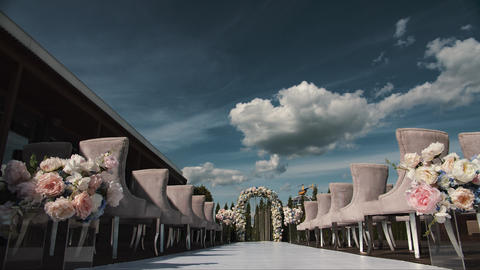 Timelapse of a beautiful wedding decoration before ceremony in 4K. Blue sky and GIF