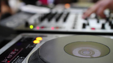 Hands of a DJ which spins and mixes music buttons during a concert show social e Footage