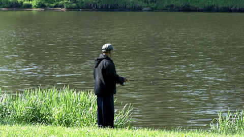 Fisherman Casts Spinning in Lake Footage