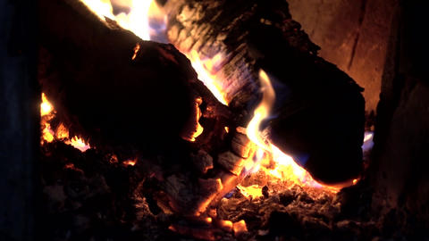 Close up of burning wood fireplace in a stove with glowing fire Footage