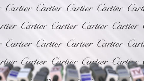 News conference of CARTIER, press wall with logo as a background and mics Footage