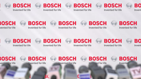 News conference of BOSCH, press wall with logo as a background and mics Live Action