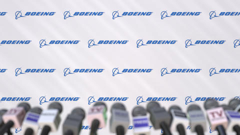 News conference of BOEING, press wall with logo as a background and mics Footage