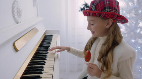 Girls playing piano Footage