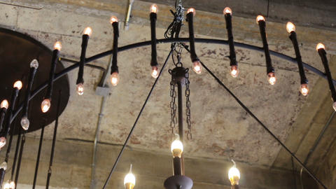 Classic retro light bulbs decorated in loft room ceiling Live Action