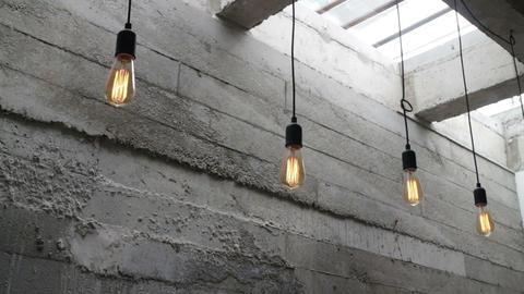 Vintage interior hanging light bulb in loft room Stock Video Footage