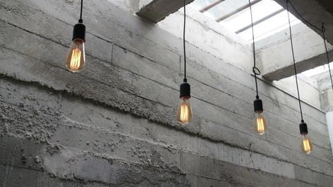Vintage interior hanging light bulb in loft room Footage