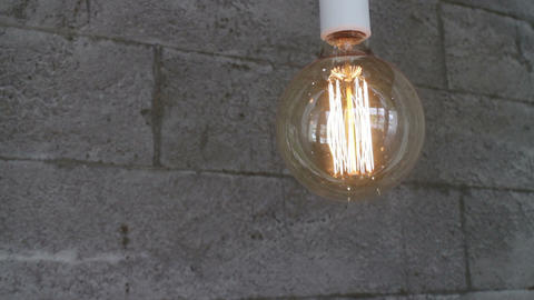 Single vintage retro light bulb Footage