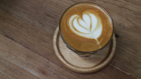 A Cup of Piccolo latte coffee with latte art Live Action
