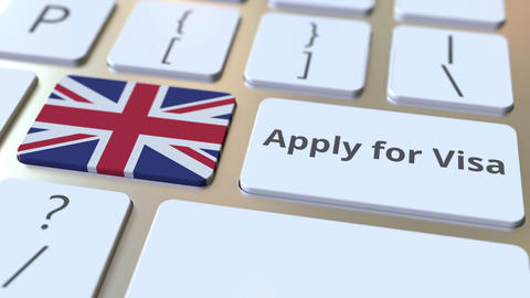 APPLY FOR VISA text and flag of Great Britain on the buttons on the computer Live Action