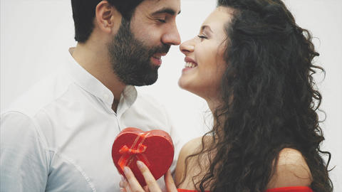 Beautiful young couple. Hugging a kiss and enjoying it together. Valentine's Day Footage