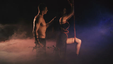 A couple in a intimal moment. Man and woman. Bdsm theme Footage
