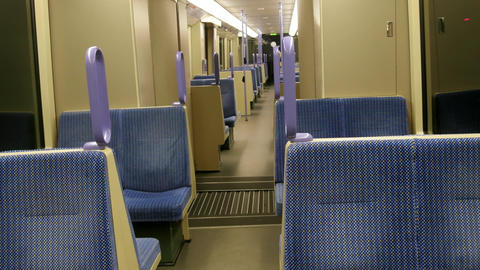 In a commuter train, seats in car are empty Footage