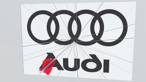 AUDI company logo being hit by archery arrow. Business crisis conceptual Live Action