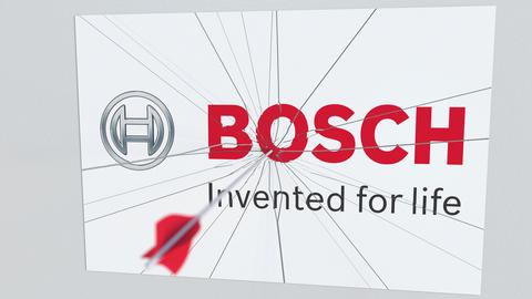 Archery arrow breaks glass plate with BOSCH company logo. Business issue Live Action