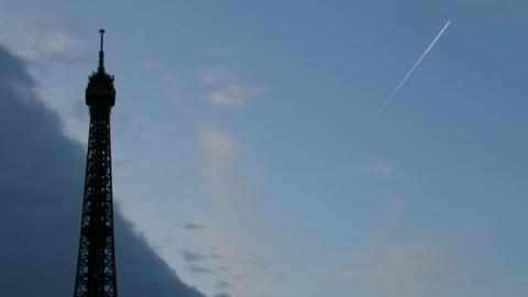 Eiffel tower pierces evening sky Live Action
