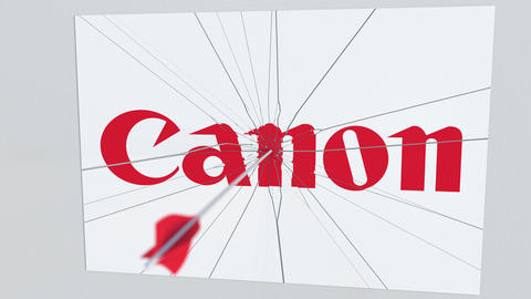CANON company logo being hit by archery arrow. Business crisis conceptual Live Action