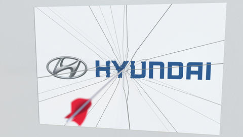 HYUNDAI company logo being hit by archery arrow. Business crisis conceptual Live Action