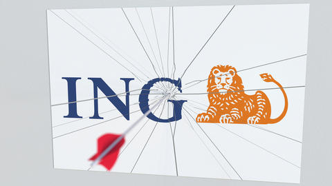 Archery arrow breaks glass plate with ING company logo. Business issue Live Action