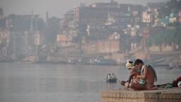 Hindu man doing excercise at the Ganges,Varanasi,India Footage