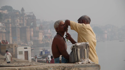 A man gets a shave at the Ganges,Varanasi,India Footage