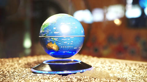 Blue Planet Earth background Globe spinning on magnetic power model Footage