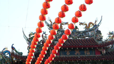 Row of red Chinese paper lanterns with ornate gold patterns and tassels. hanging Footage