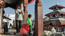 People on top of temple on Durbar square,Kathmandu,Nepal Footage