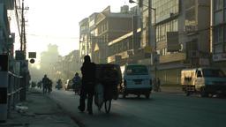 Busy road with man crossing,Kathmandu,Nepal Footage