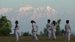 Kids learning Kungfu with Himalaya background,Bandipur,Nepal Footage