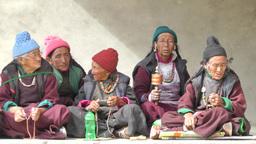 Older spectators with praying wheels ,Lamayuru,India Footage