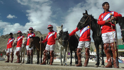 Polo jockeys in Red before the match,Leh,India Footage