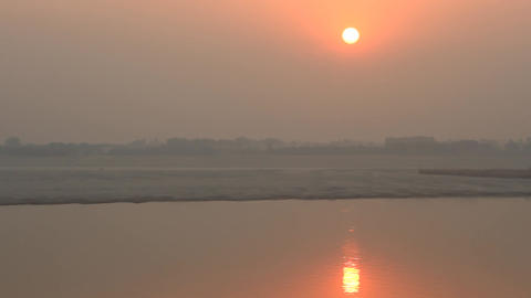 Misty sunset over the calm winter river Ganges Footage