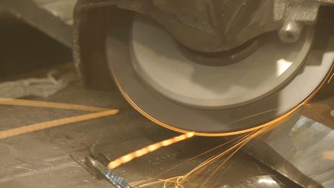 Metal Cutting Saw. Metal cutting saw cuts a steel. Sparks fly in all directions Live Action