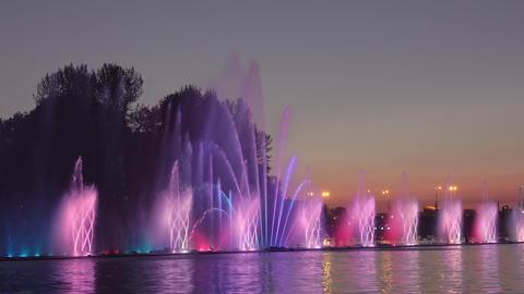 Illuminated Fountain and City Sunset Footage