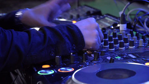 Close-up of DJs played at music events during play Live Action