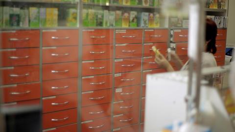 Pharmacist taking medicines for customer ビデオ