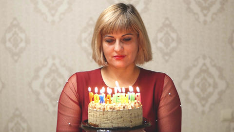 Adult woman blowing out candles Footage
