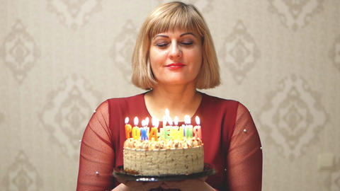 Adult woman blowing out candles Stock Video Footage