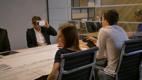 Employee and his colleagues working with VR Future technology concept and Footage