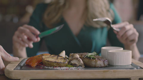Steak and grill vegetables service and woman hands Live Action