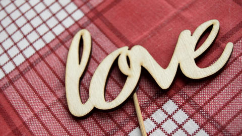 Love the word. Love the wooden letters on the red checkered napkin Live Action