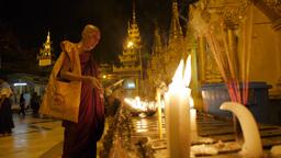 Monks lighting candles at Schwedagon Pagoda,Yangon,Burma Footage