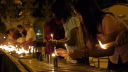 Girls lighting candles at Schwedagon Pagoda Footage