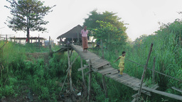 Rickety small bridge, with father and child,Hpa-An,Burma Footage